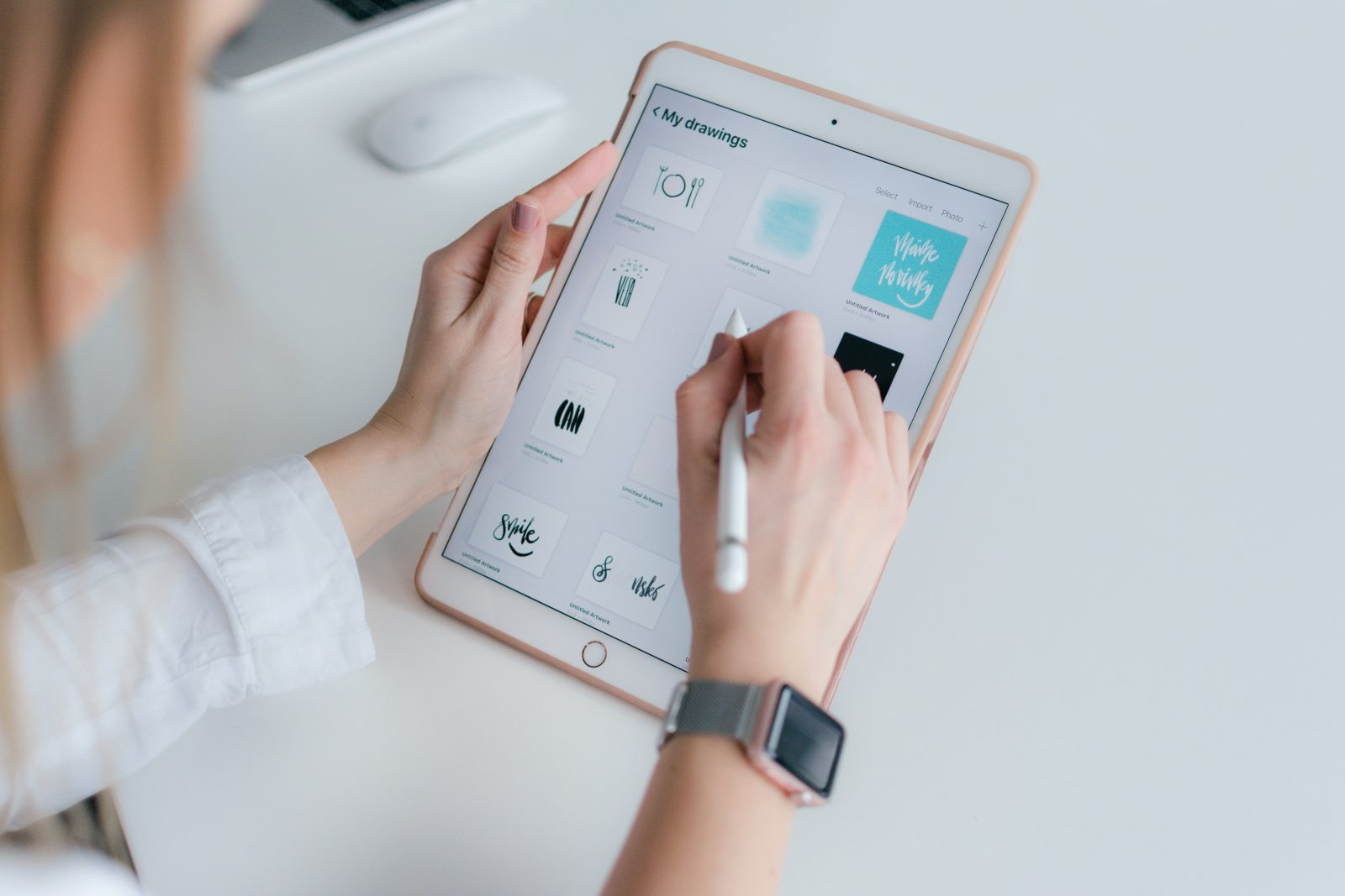 woman using rose gold iPad