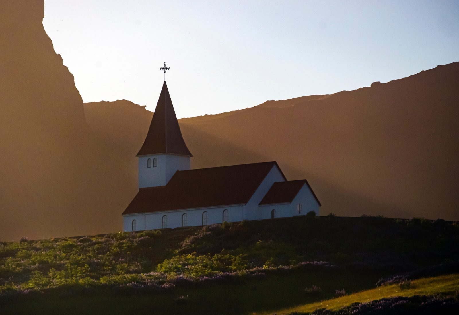 white and brown chapel during golden hour